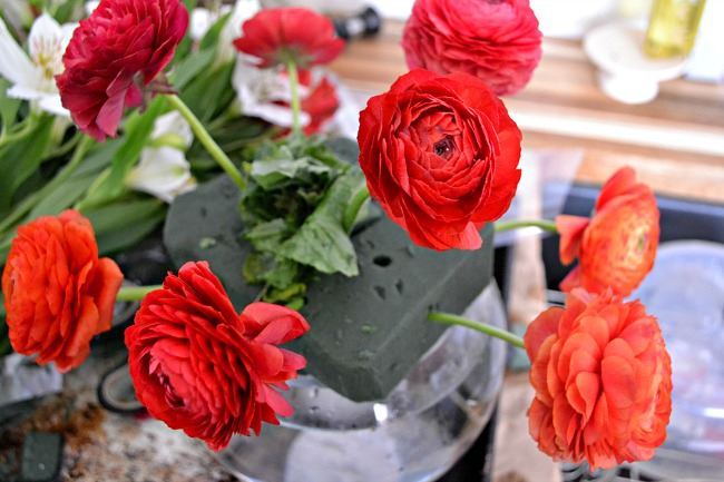 farmers market flower bouquets with red ranunculus and radishes