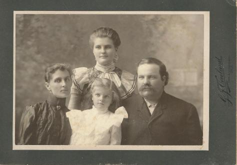 Atlanta B Crouch and her husband are shown left and right; their daughter Iona is center, and daughter (my great-grandmother) Grandmother Coward is shown top center.