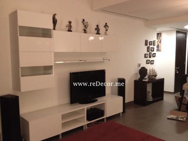 living room with white ikea wall unit