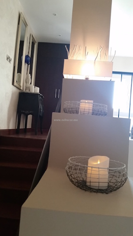 electronic candles, staircase interior decor, wooden staircase, Dubai interiors