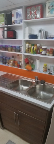 white kitchen with corian orange backsplash and white poppy counter, design