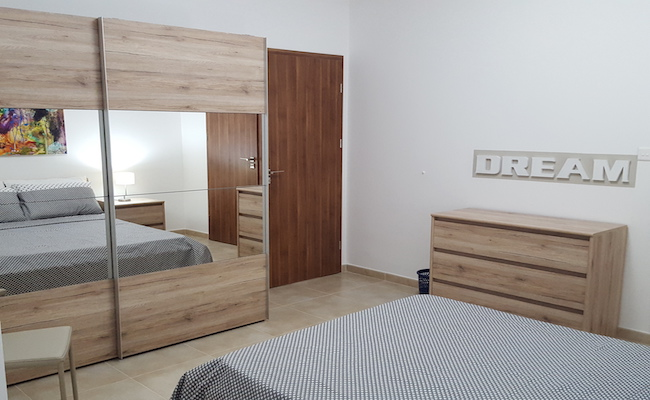 mirror wardrobe, modern bedroom decor, simple, malta fit outs, consultation, apartment for rent in Malta