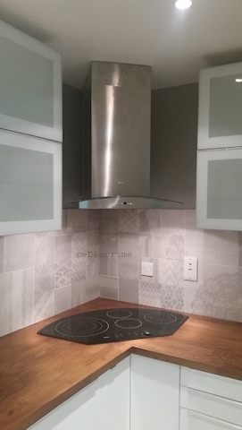 corner hood and hob, organised kitchen ceiling, wood looking floor tiles for the kitchen, modern tiles, grey patterns, Kitchen remodeling in Old Greens, dubai, design and consultation, wooden kitchen counter, floor wood looking tiles