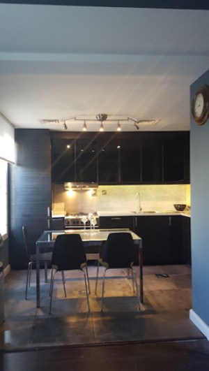 black kitchen remodelling, Springs dubai, grey work top, built in range hood , design consultation