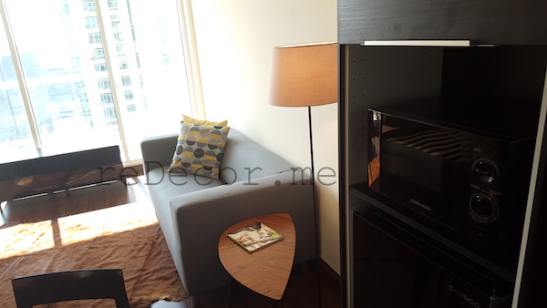 small living, entrance, mirror, enlarge space, wooden flooring, living small homes, studio before, small place design, layout, kitchen remodelling, black kitchen with yellow splash back, design by erika pace, dubai, burj nujoom studio