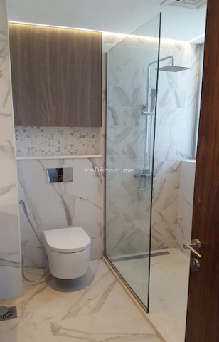 bathroom fit out dubai, storage above WC, remodelling business bay, executive tower, walk in shower, built in bathroom shelves, storage, marble, under counter basins, special lighting, interior design dubai, consultation, bagno bathrooms