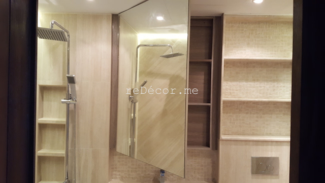 bathroom fit out dubai, remodelling business bay, executive tower, walk in shower, built in bathroom shelves, storage, marble, under counter basins, special lighting, interior design dubai, consultation, bagno bathrooms, mirror storage, light, storage above wc, laundry basket build in storage, before and after bathroom