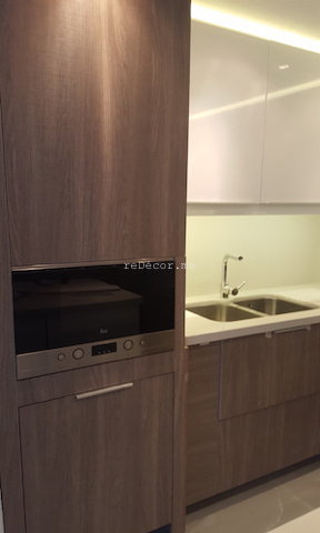 kitchen remodelling fitout dubai, modern kitchen executive towers, business bay kitchen, stone counters, island kitchen, corner storage, built in washing machine, teka basin