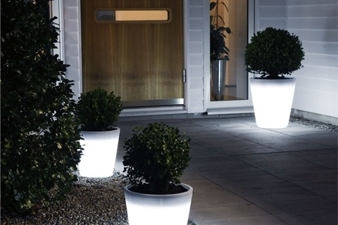 Assisi LED Planter lights your way through a nighttime garden