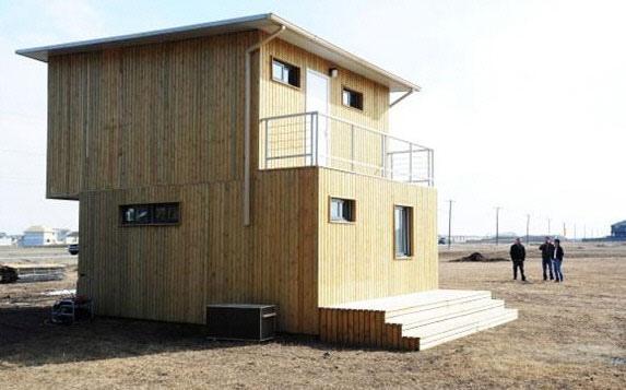 Container House – $60,000 home builds in four days with 3 workers, a crane, wrench and a drill