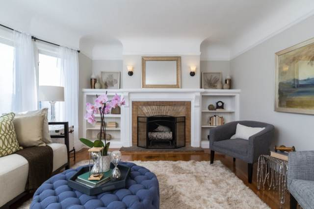 A living room with a brick fireplace as the focal point