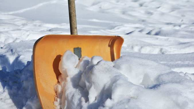Yellow shovel for shoveling snow when selling your home during the holidays