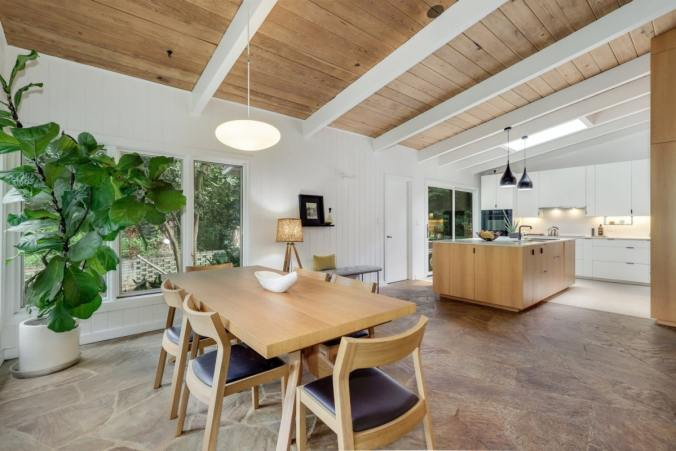open concept kitchen wood dining table