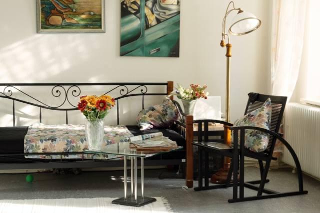 black wicker chair floral pillows