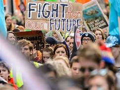 """placard says """"fight for our future"""""""