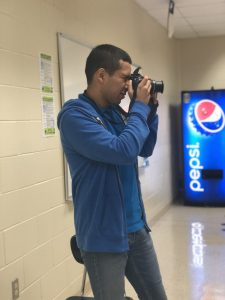 student focusing by taking a picture