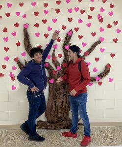 carter students standing in front of tree of hearts