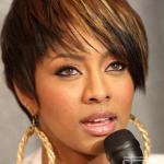 Keri Hilson with short sleek haircut and copper and blonde highlights