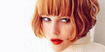 Short red bob hairstyle with bangs