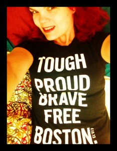 "JoEllen taking a selfie in bed, wearing a t-shirt that reads ""tough, proud, brave, free, Boston"""
