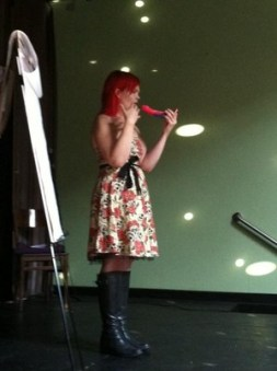 JoEllen onstage about to put a dildo in her mouth