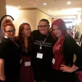 JoEllen poses with a group at Woodhull's Sexual Freedom summit