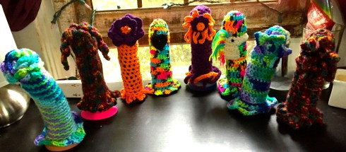 8 brightly colored crocheted dildo cozies