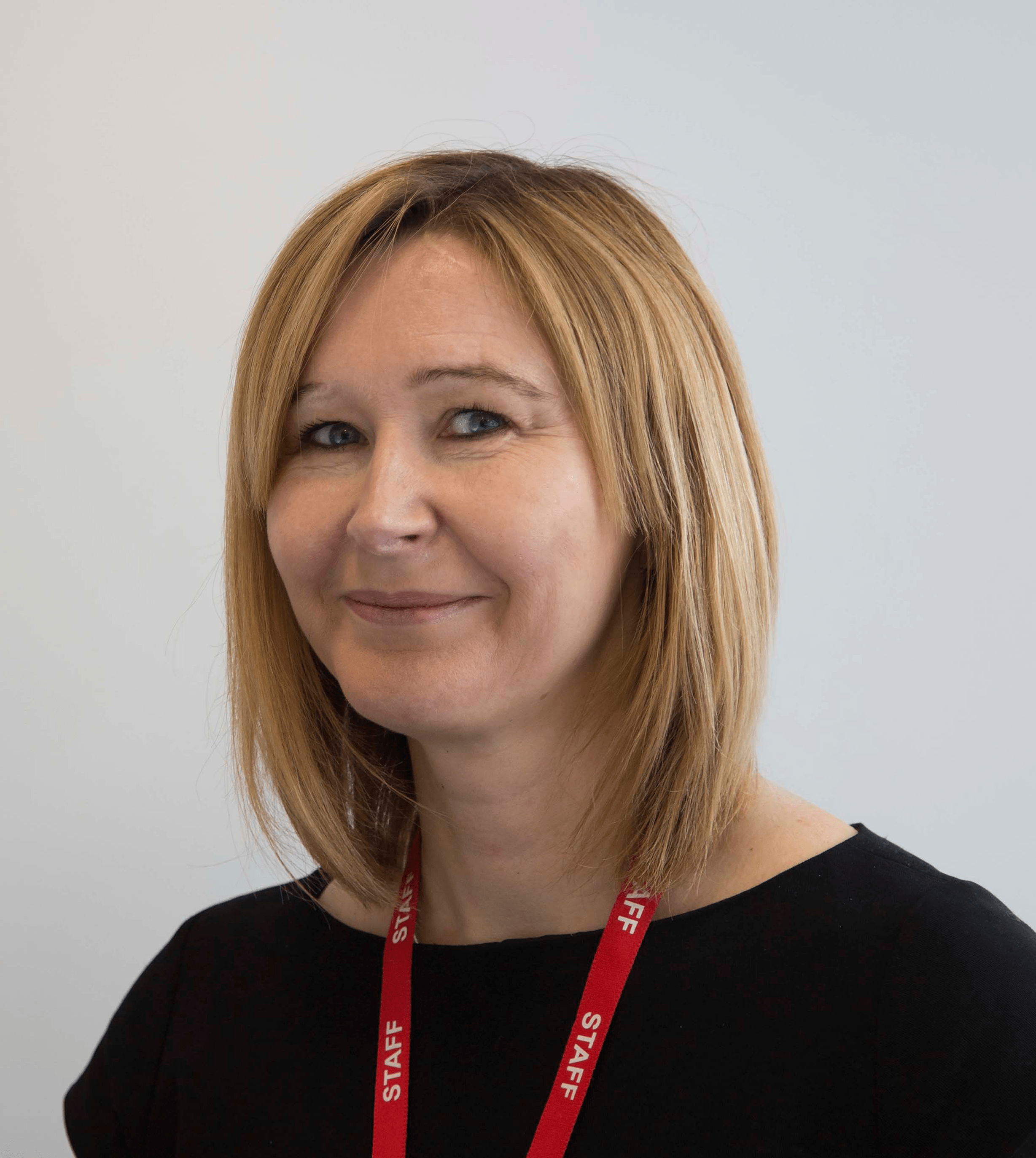 A headshot photograph of Liz Wright, Red Hen Project Manager