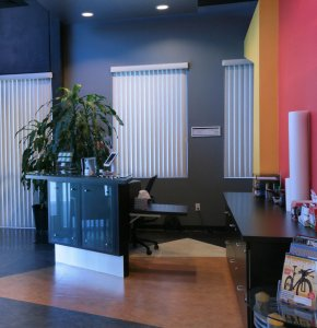 Entrance of Redlands Spine and Sport - Large windows with modern desk