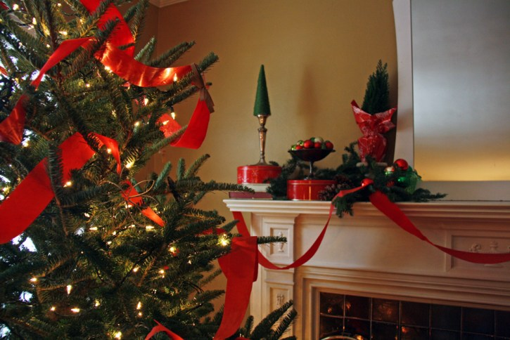 Christmas tree and fireplace mantle in red and green.