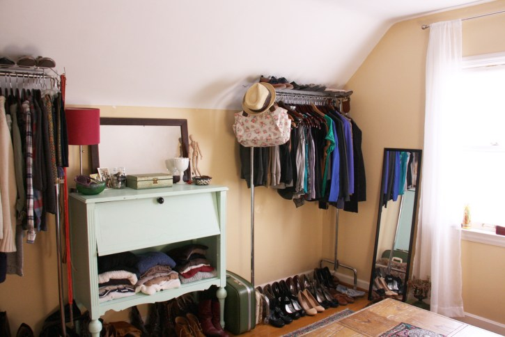 Room with two clothes racks.