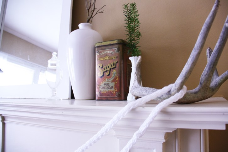 Finger knit garland displayed on a mantle.