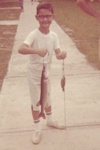 Me at Camp Easter Seal age 10, with a fish I DID NOT catch