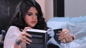 Selena Gomez reading 50 Shades of Grey