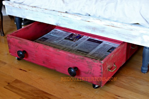 Under bench storage lined with newspaper redouxinteriors