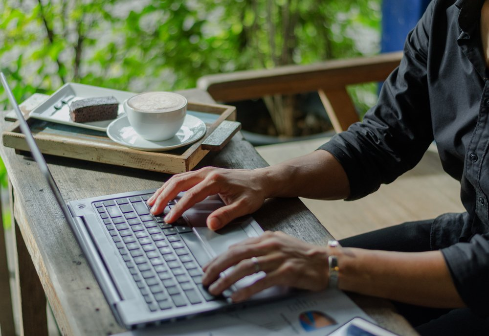 What is a digital nomad? It's much like this businessman working on his laptop from a remote destination.