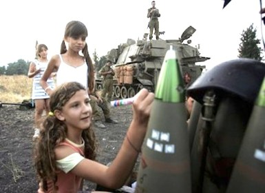Israeli girl writes on a bomb