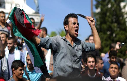 Palestinian protester wielding a knife