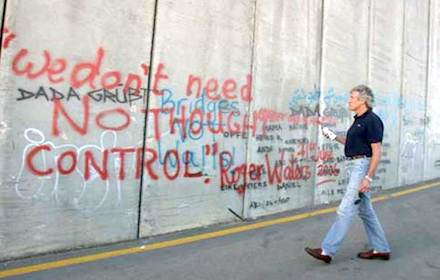 "Roger Waters writing ""We don't need no thought control"" on Israel's apartheid wall"