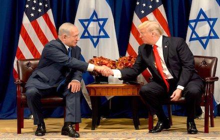 Netanyahu and Trump shaking hands