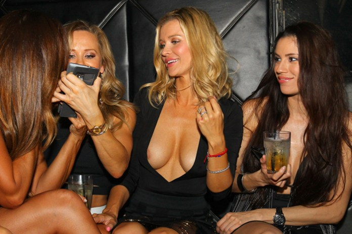 EXCLUSIVE: Joanna Krupa has girls night out at Mynt Lounge in Miami Beach. The reality star and her friends, including former cast mate Karent Sierra, danced and enjoyed the night as they played in the DJ booth, poured each other shots, and took selfies throughout the night. While letting her hair down and partying in the club owned by her husband Romain, Joanna had a slight wardrobe malfunction accidentally exposing herself to the crowd in the club. Pictured: Joanna Krupa Ref: SPL1149107  111015   EXCLUSIVE Picture by: Ralph Notaro / Splash News Splash News and Pictures Los Angeles:310-821-2666 New York:212-619-2666 London:870-934-2666 photodesk@splashnews.com