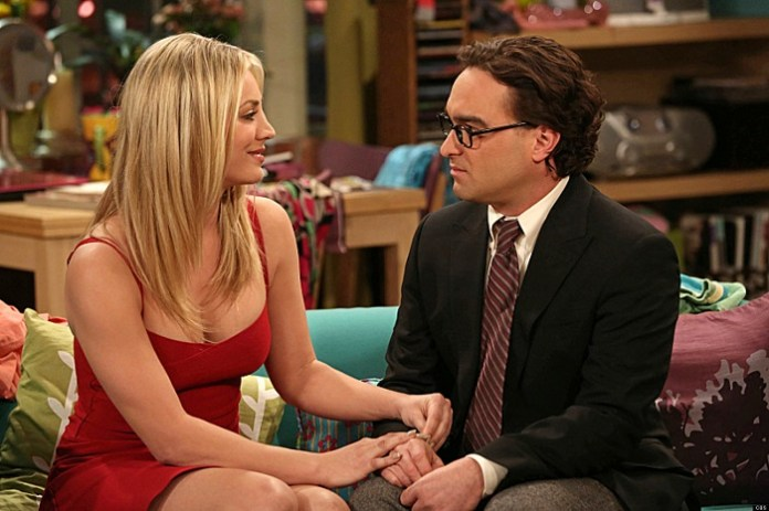 """""""The Tangible Affection Proof"""" –  While the guys try to give their significant others the perfect Valentine's Day, Raj and Stuart throw a """"lonely people"""" party at the comic book store, on THE BIG BANG THEORY, Thursday, Feb. 14 (8:00 – 8:31 PM, ET/PT) on the CBS Television Network. Left: Penny (Kaley Cuoco), Right: Leonard (Johnny Galecki). Photo: Michael Yarish/Warner Bros. ©2013 Warner Bros. Television. All Rights Reserved."""