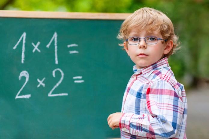bigstock Preschool Kid Boy With Glasses 92099381
