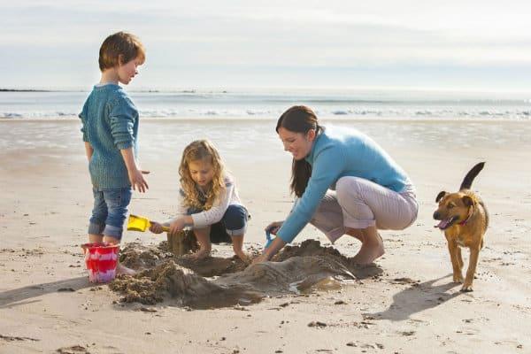 Family enjoying beach with dog Long Beach CA