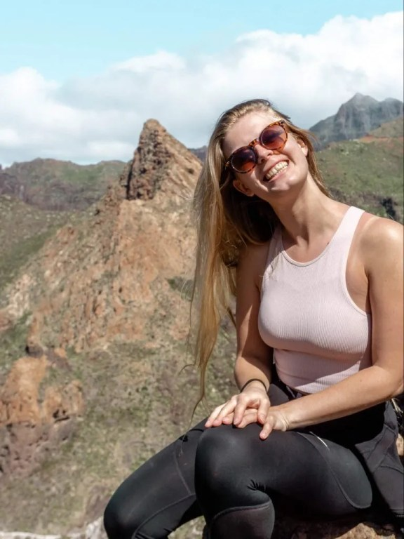 Jo smiling at the top of a hike in Tenerife.