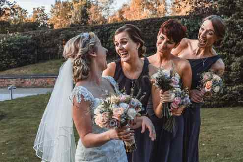 wedding photography of bridesmaids laughing
