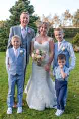 Wedding photography of the bride and groom with children