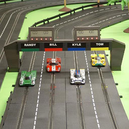 Reed switches in lap counter in slot car racing