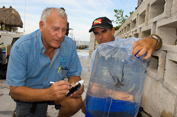 John Halas and Lad Akins with Lionfish