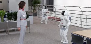 Here ASIMO meets and greets a visitor